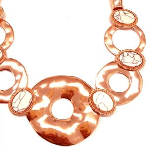 Costume jewellery large chunky statement style with a rose gold colour choker necklace