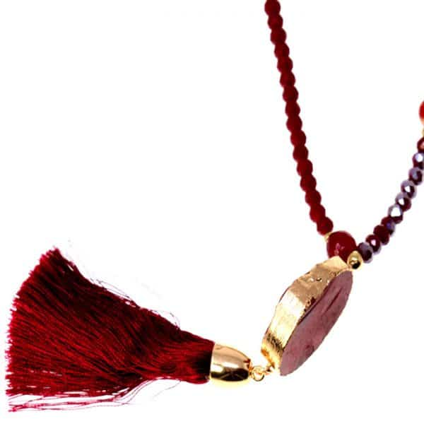 Genuine red agate tassel pendant on a bead long fitting necklace