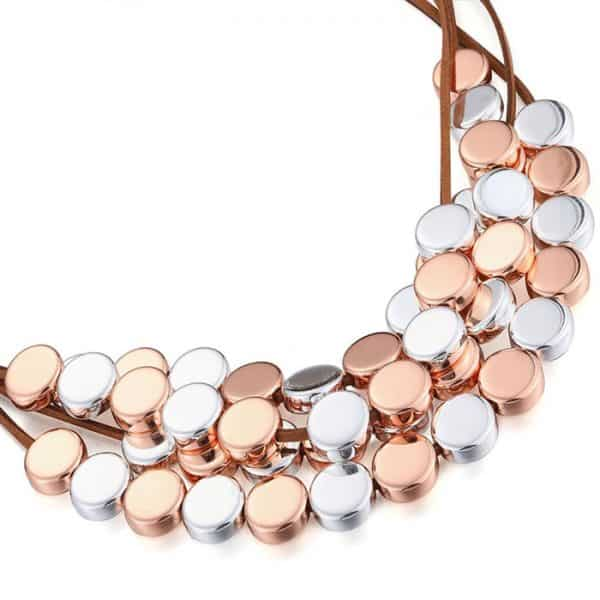 Rose gold and silver colour layered round disc on a brown leather choker necklace