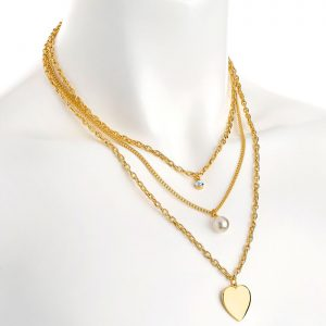 Layered gold colour cream pearl with crystal and heart charm chain necklace
