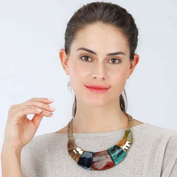 Costume jewellery colourful acrylic resin jewellery with a gold colour collar statement necklace