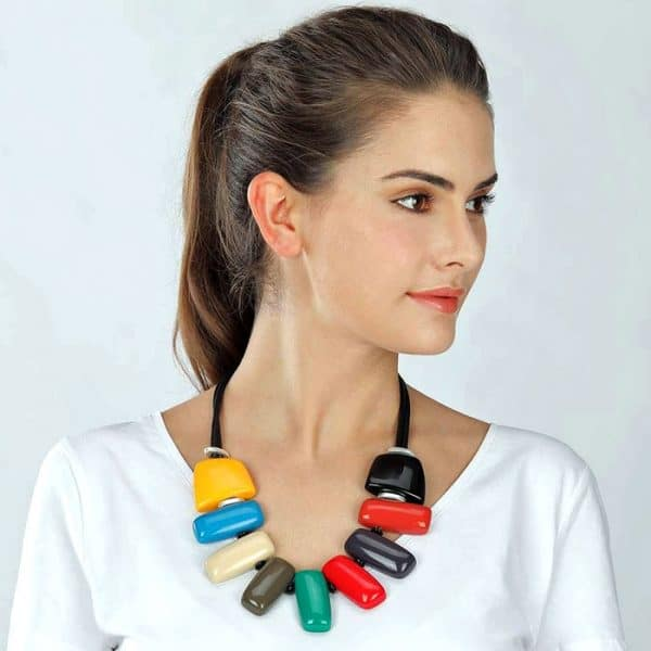 A rainbow colour necklace with pebbles in shapes of a rectangle and two square shapes on both sides
