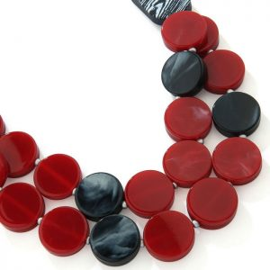 Costume jewellery necklace with two black oval beads with draping circles in red and black colours