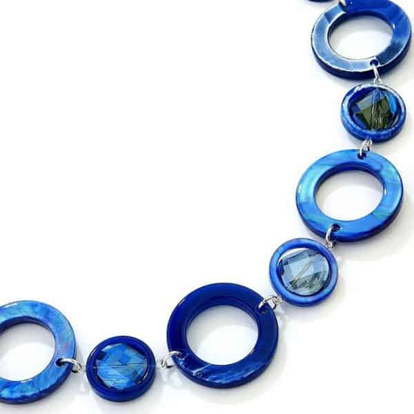 Blue acrylic resin and crystal disc on a silver colour chain long fitting necklace