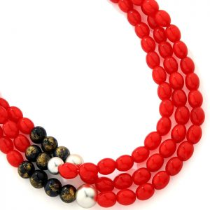 Costume jewellery layered necklace full of red oval beads and gold-tinted black and silver beads