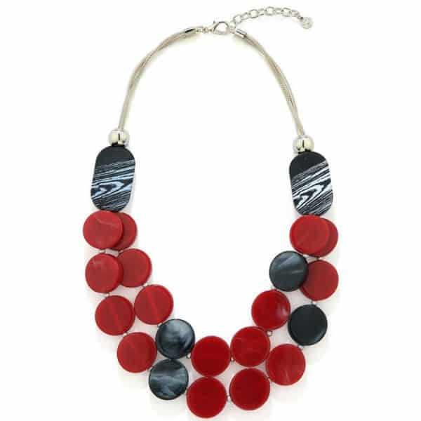 A necklace with two black oval beads with draping circles in red and black colours