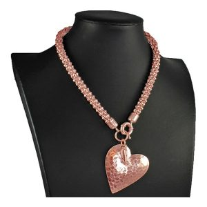 Rose gold large hammered heart pendant on a choker necklace