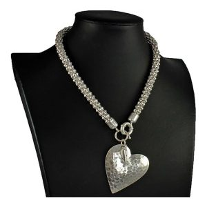 Matte silver large hammered heart pendant on a choker necklace