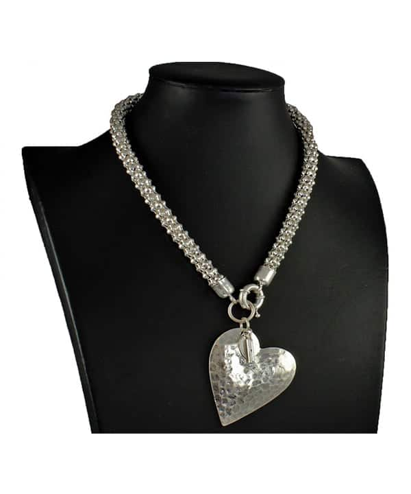 Matte silver colour large hammered heart pendant on a chunky choker necklace
