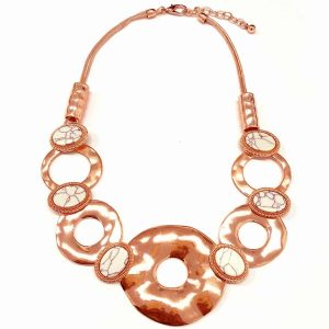 Large chunky statement choker necklace with a rose gold colour metal and stones