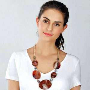 Fashion jewellery large brown acrylic resin oval-shaped disc with stones on a long necklace