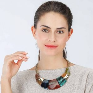 Colourful acrylic resin jewellery with a gold colour collar statement necklace