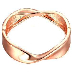Costume jewellery rose gold colour twisted spring hinge slave bangle