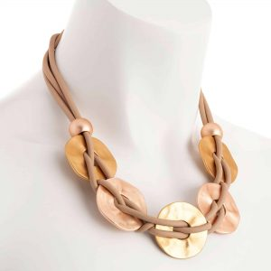 Matt gold colour large disc on a beige rubber cord choker necklace