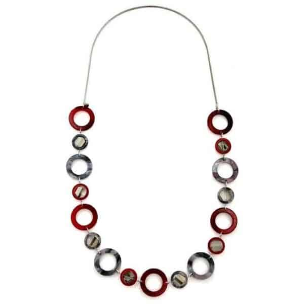 A long necklace with alternate sizes of glossy acrylic hoops