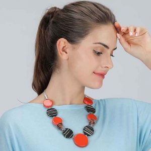 Beautiful orange and black large acrylic discs on a metal chain choker necklace