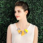 Yellow and orange abstract shape pendants on a choker necklace