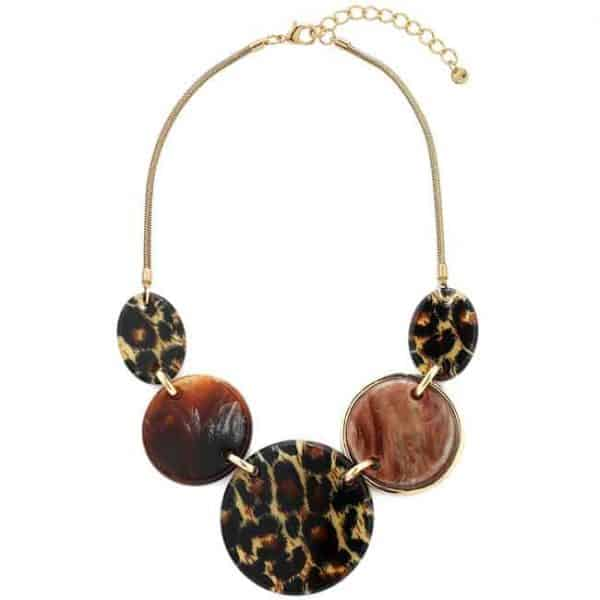 Striking tribal animal style large acrylic resin disc on a gold colour chain statement necklace